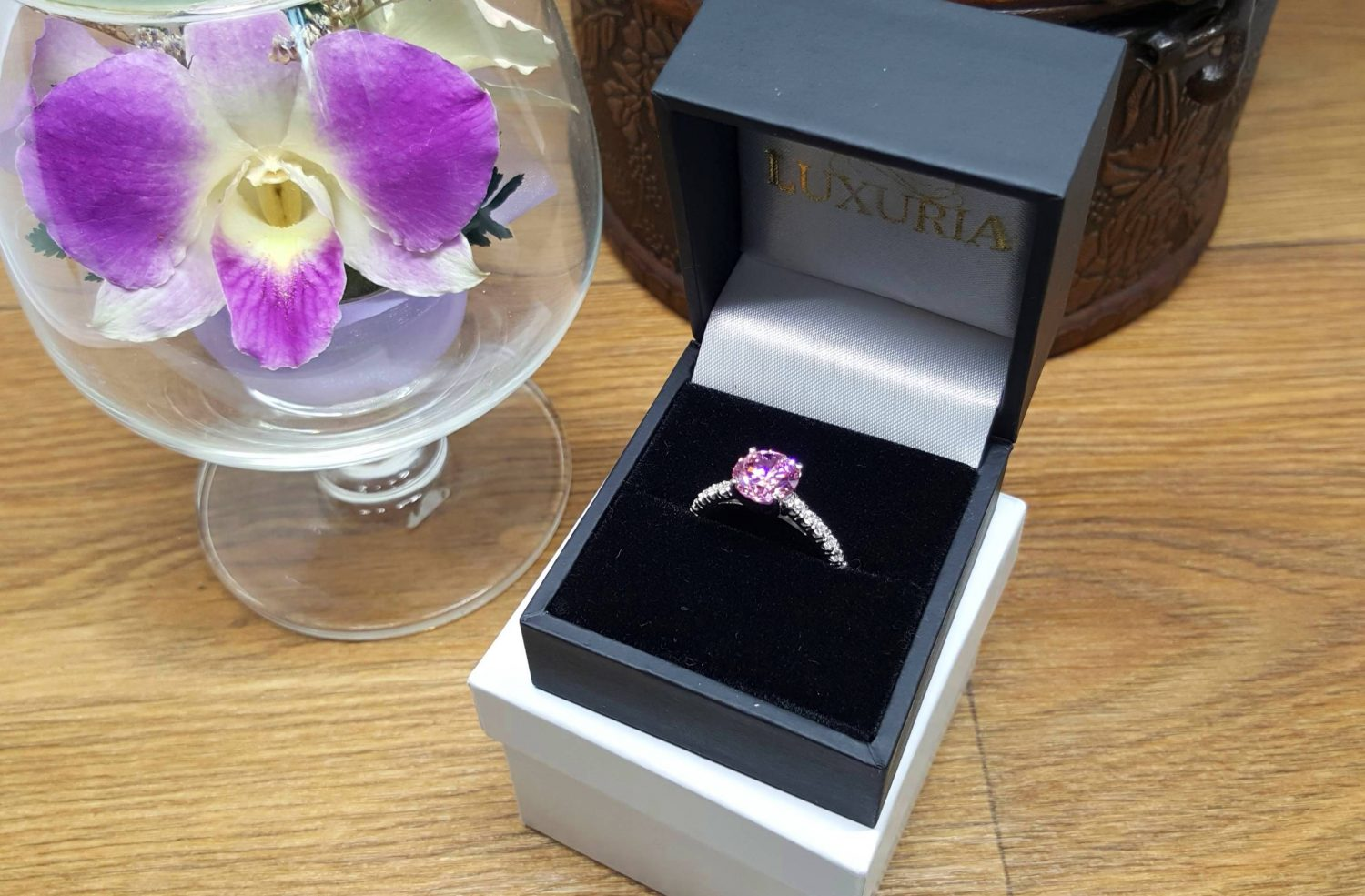 Photo of a cubic zirconia engagement ring inside a beautiful leatherette box