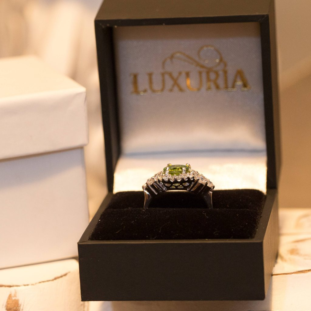 LUXR125-6 Luxuria peridot rings with deluxe leatherette ring box