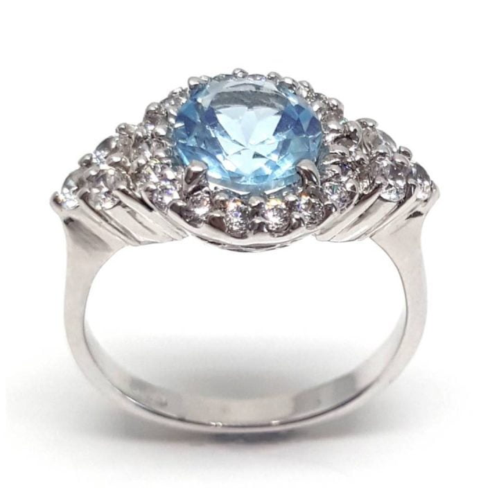 LUXR124 Fake diamond rings with blue topaz central gemstone