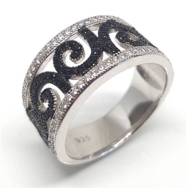 Unfurling fern leaf pattern ring from Luxuria is inspired by nature. Set in 925 silver with black rhodium koru shape. Don't miss this.