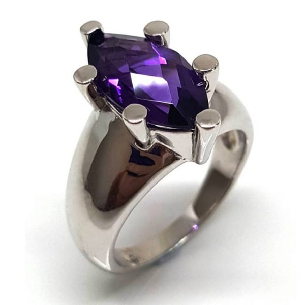 Like to make a cocktail or dinner party statement? Look no further than this delightfully bold modernist Amethyst gemstone and sterling silver ring! Featuring a central solitaire marquise shape purple amethyst gem of approx. 18mm top width and approx. 3.6 ct. t.w. , six prong set into a chunky 10mm wide tapered 925 sterling silver band. The band tapers to approx. 3mm at the base. This December birthstone and the 4th anniversary gem tips the scales at approx. 8.5 grams. The ring is rhodium plated to provide shine and durability. Perfect for us bigger girls with fatter fingers, not every girl can wear this ring - but maybe you can!