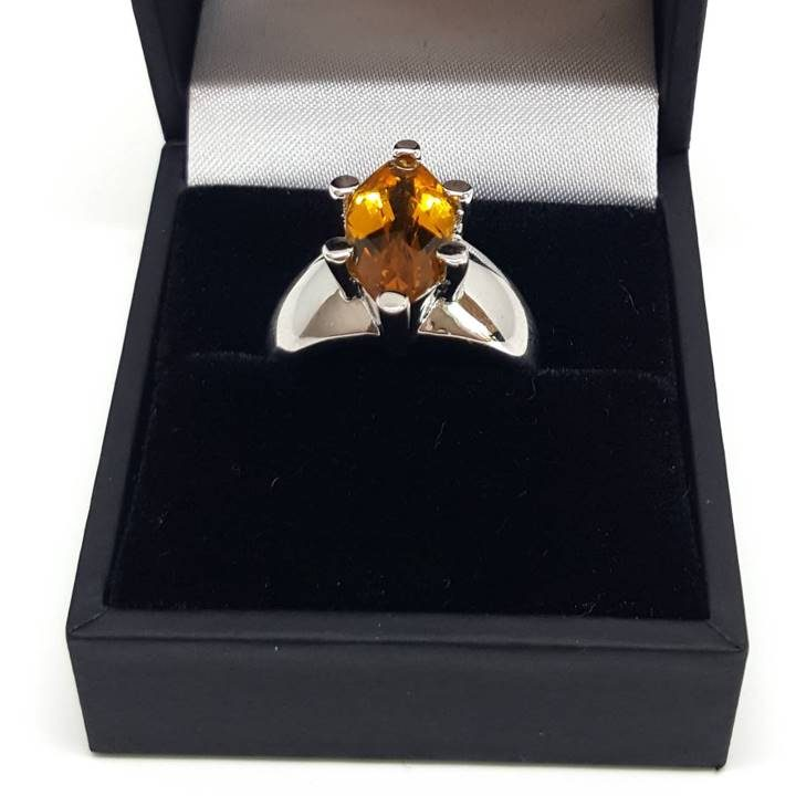 Luxuria A gemstone ring for us bigger girls. A large marquise shape yellow color citrine gem set in a chunky 925 silver band is best suited to larger fingers.