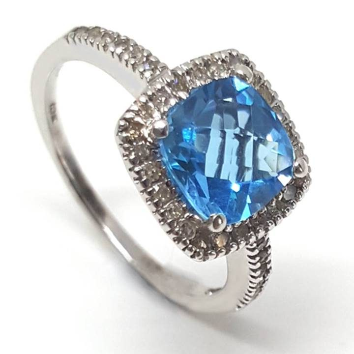Luxuria Captivating cushion cut blue topaz and round cut diamond halo gemstone engagement ring