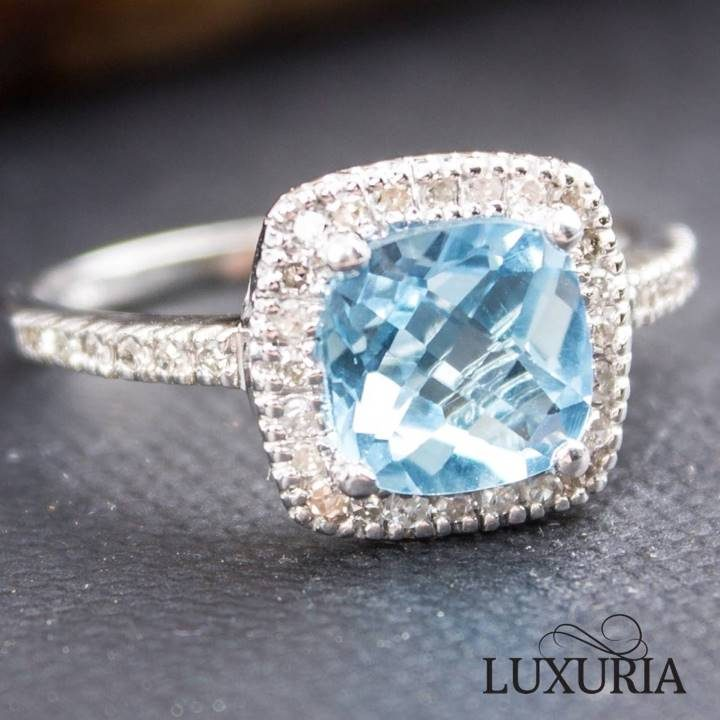 Luxuria blue topaz and diamond engagement ring in 10k white gold
