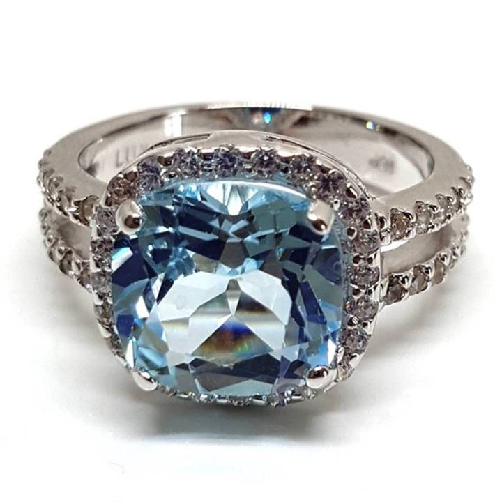 Luxuria - fake wedding rings that look real with topaz gem