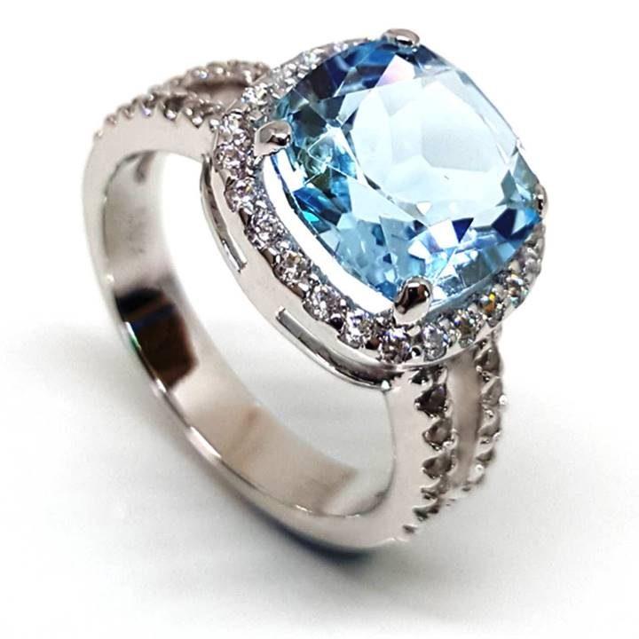 Luxuria cushion cut blue topaz gemstone with halo dress or engagement ring