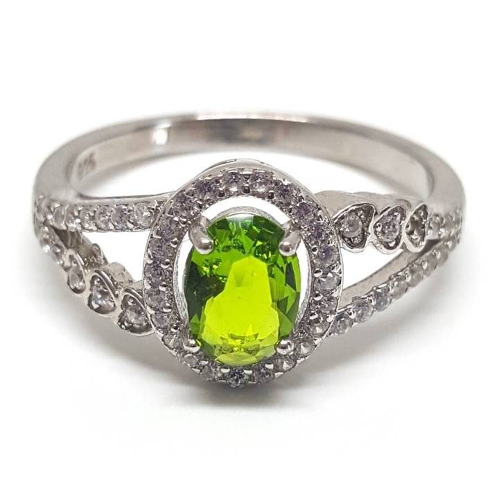 Luxuria peridot coloured oval shaped and cut central stone dress ring with halo set in 925 silver