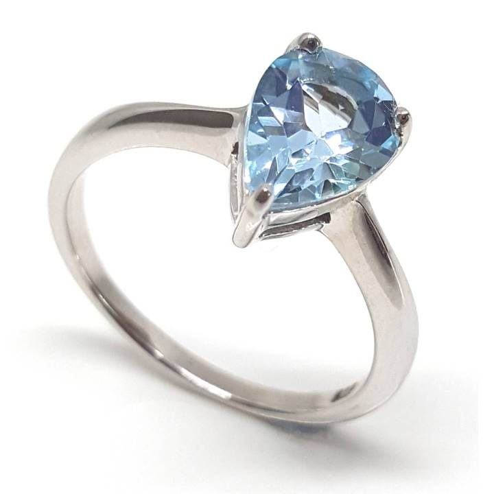 Luxuria. Capture the color of a blue sky summer with this pear shaped solitaire blue topaz gemstone ring. 925 silver and plated in rhodium for shine and durability