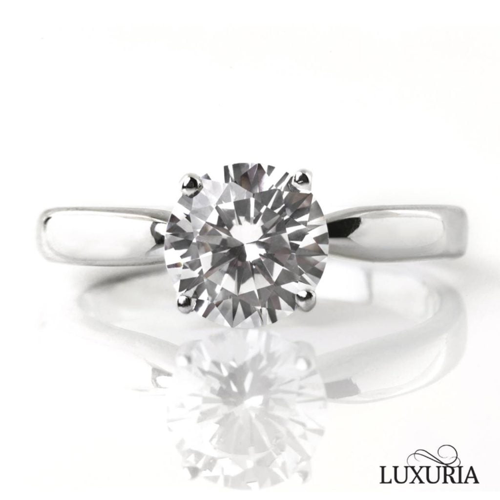 Luxuria faux diamond rings. Classic solitaire round star cut engagement ring cz