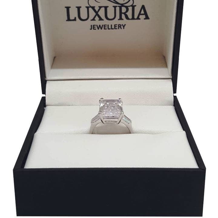 Luxuria sterling silver engagement rings. Emerald & bar set tapered baguette step-cut trapezoid diamond simulants