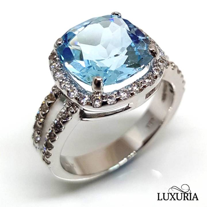 Birthstone engagement rings from Luxuria blue topaz gemstone