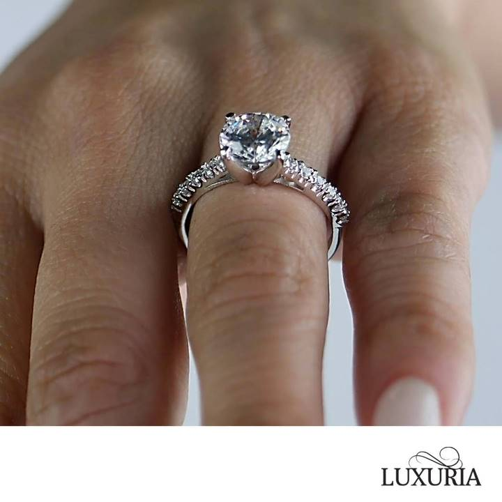 CZ engagement ring from Luxuria Jewellery brand photo on hand