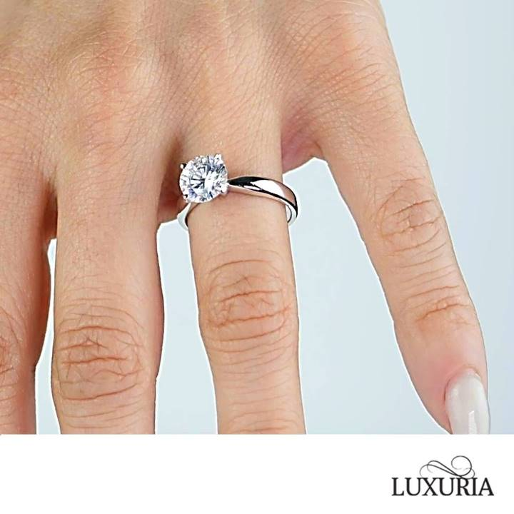 Imitation diamond engagement ring that looks real from Luxuria photo on hand