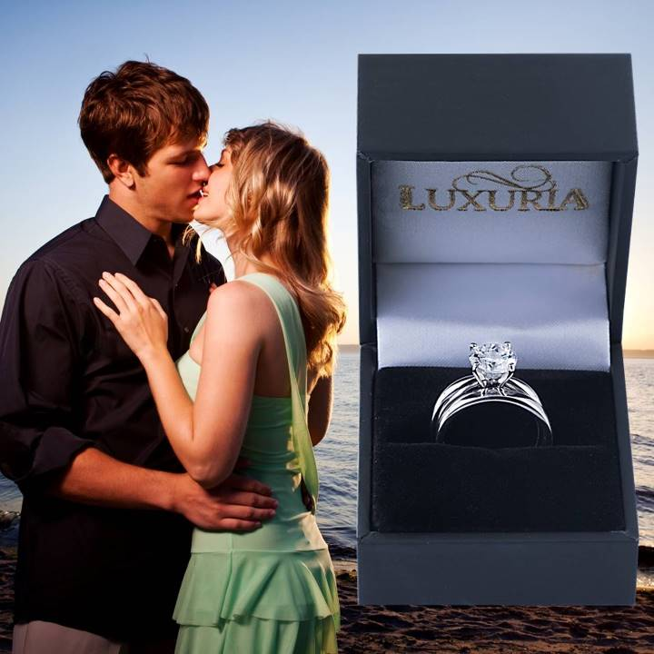 Solitaire engagement ring plus matching wedding band set in silver Luxuria