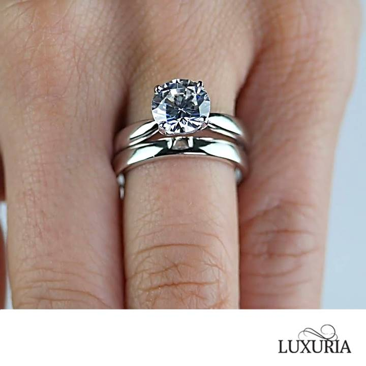 Sterling silver wedding sets ring on hand by Luxuria Diamonds