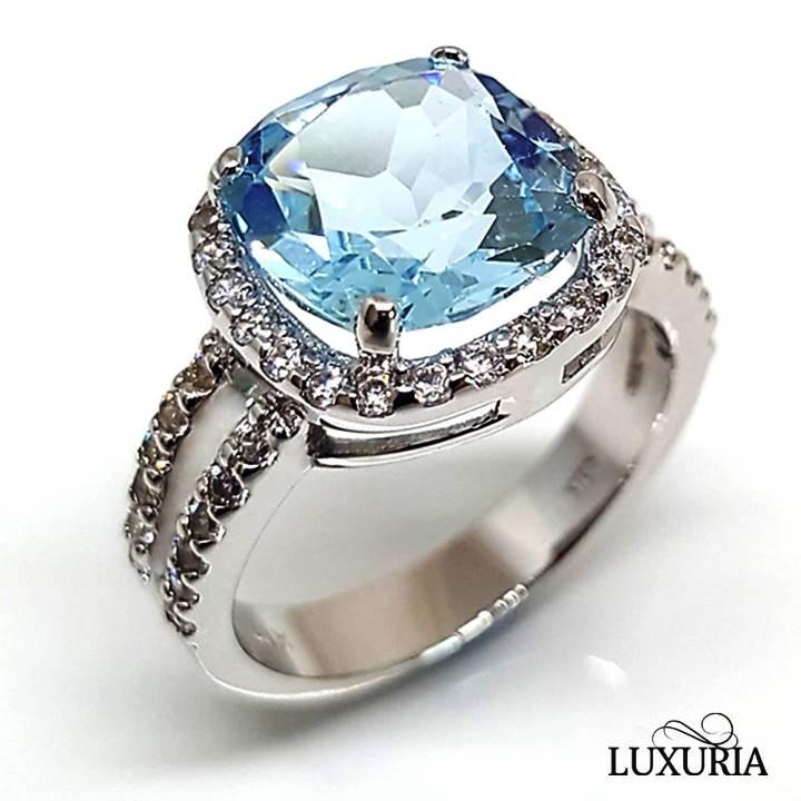 Luxuria Gemstone Rings - Blue topaz ring with diamond simulant halo