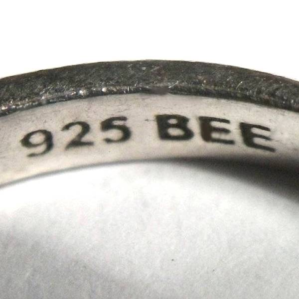 925 BEE stamp in the band of a silver ring