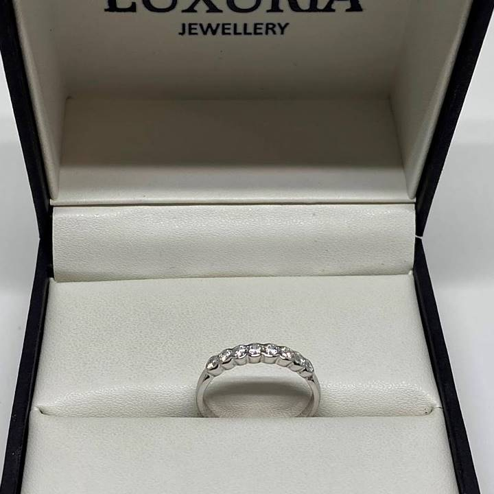 Diamond simulant sterling silver half eternity ring
